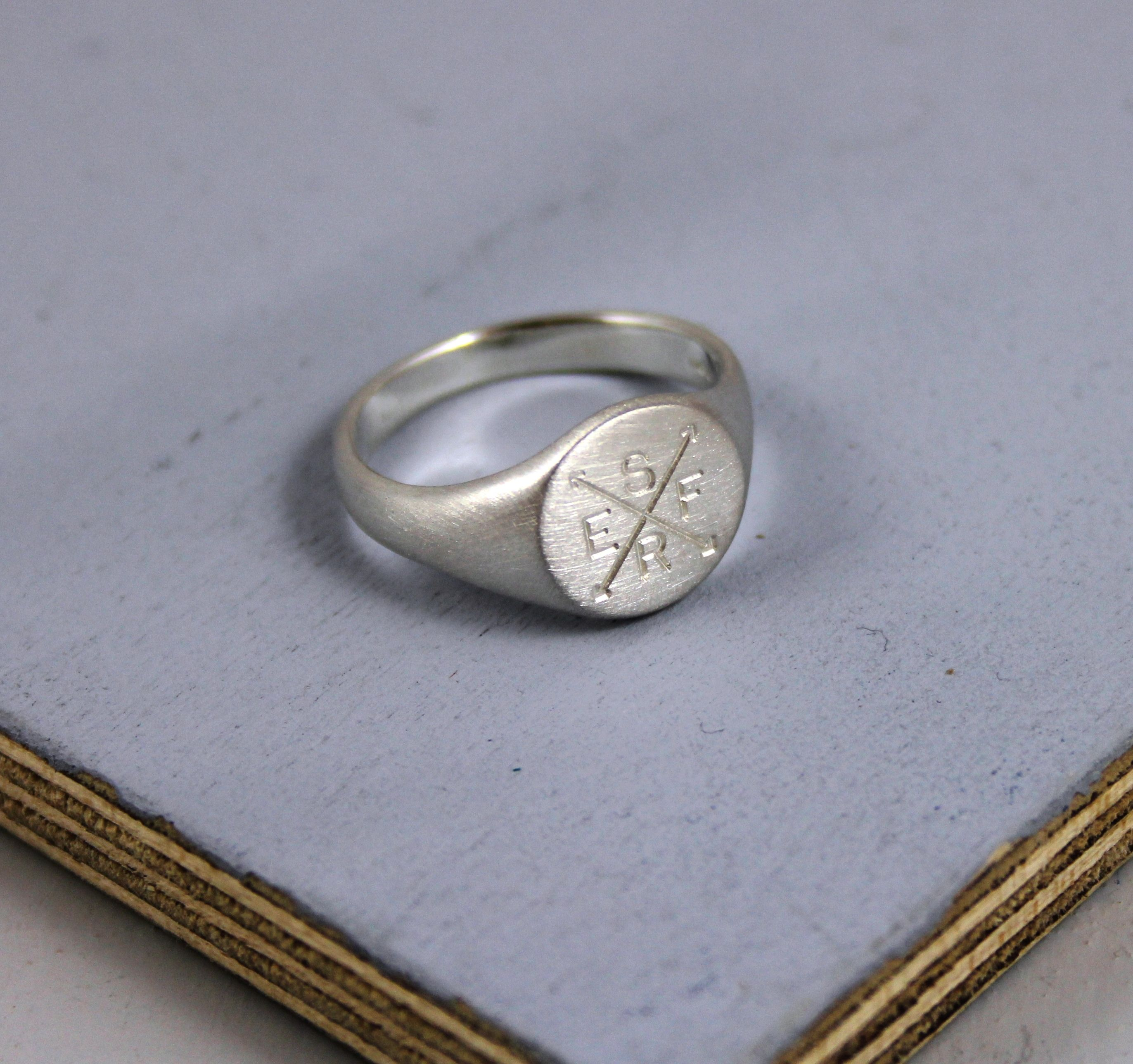 A handmade, matted, personalised signet ring engraved with your family initials - available in a wide range of sizes, perfect as a gift for both men & fashion concious women.