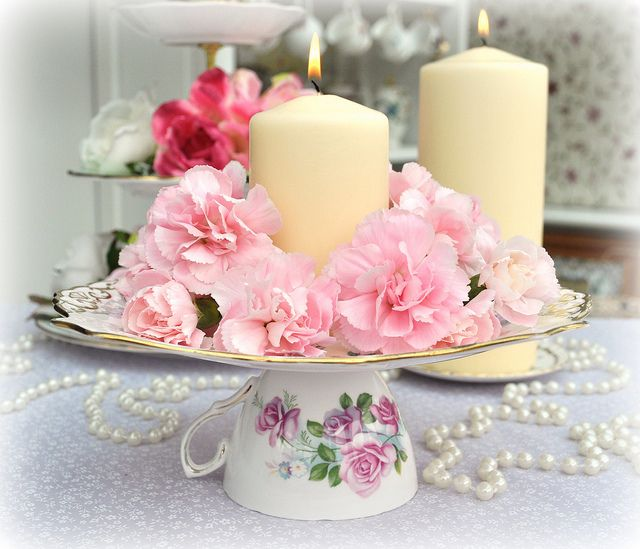 Shabby Chic Tea Party Centerpiece - just turn a teacup upside down, place  the saucer on top, add roses & a candle or place cookies etc. LIKE THE  PEARLS