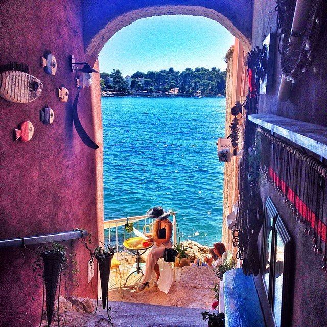 A lady enjoying her place under the sun in Rovinj
