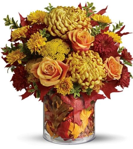 Fall centerpiece. Leaves in the vase.