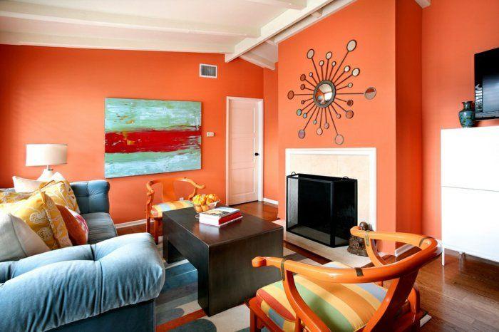 Wandfarbe Ideen Wohnzimmer Gestalten Orange Wände Kamin Hellblaues Sofa