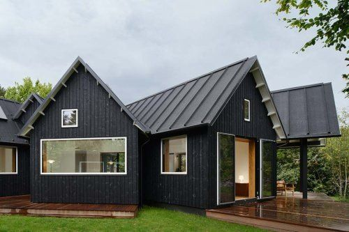 Black house with metal roof metal roofing pinterest for Black roof house