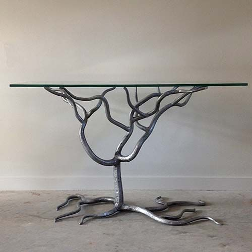 Stunning pewter finish wrought iron tree form console for Metal console tables glass top