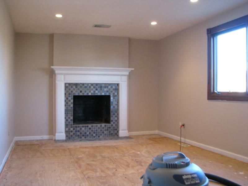 Before and after fireplace photos add space and value to - Floor to ceiling brick fireplace makeover ...