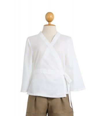 The wrap cotton top will emphasize your perfect with the small waist band in the front, combined with the adjustable drawstring belt on the back