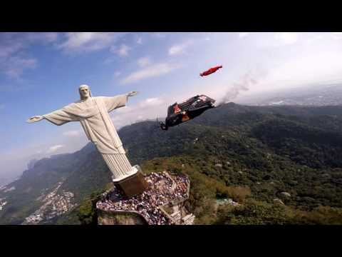 Jeb Corliss flying by Christ with friends