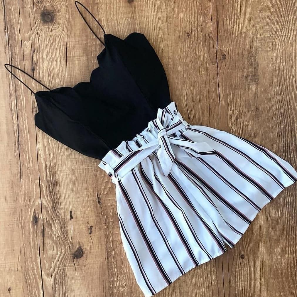 Photo of black scallop top and a white stripped paperbag bottom – per…