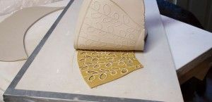 Printmaking and Pottery: Using Linocuts to Make Clay Prints