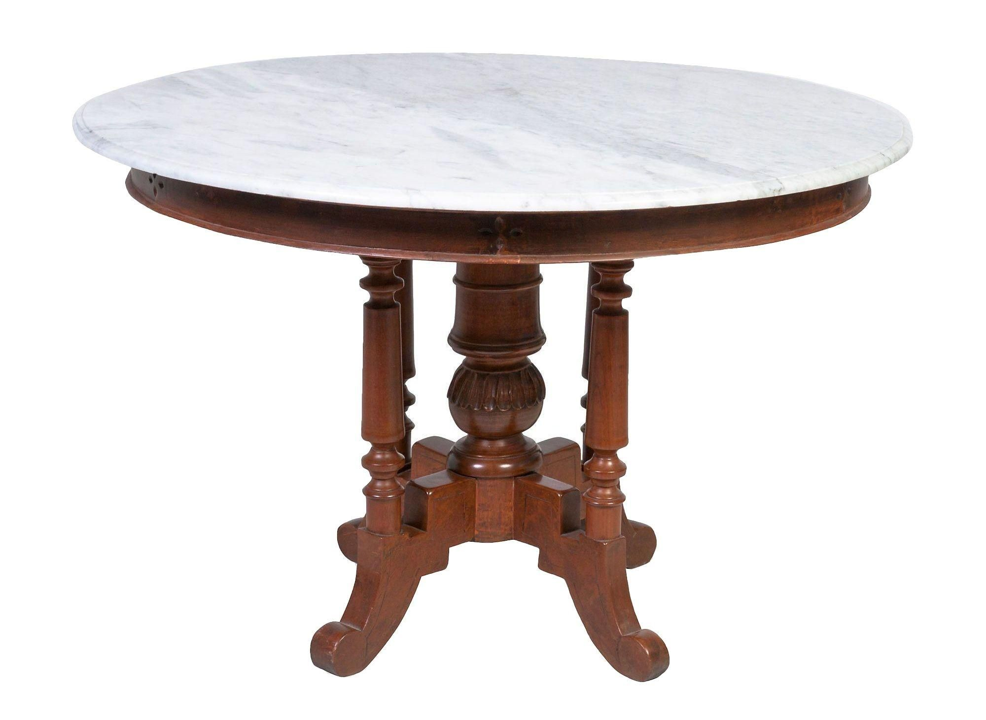 A vintage round dining table with a fabulous white marble top