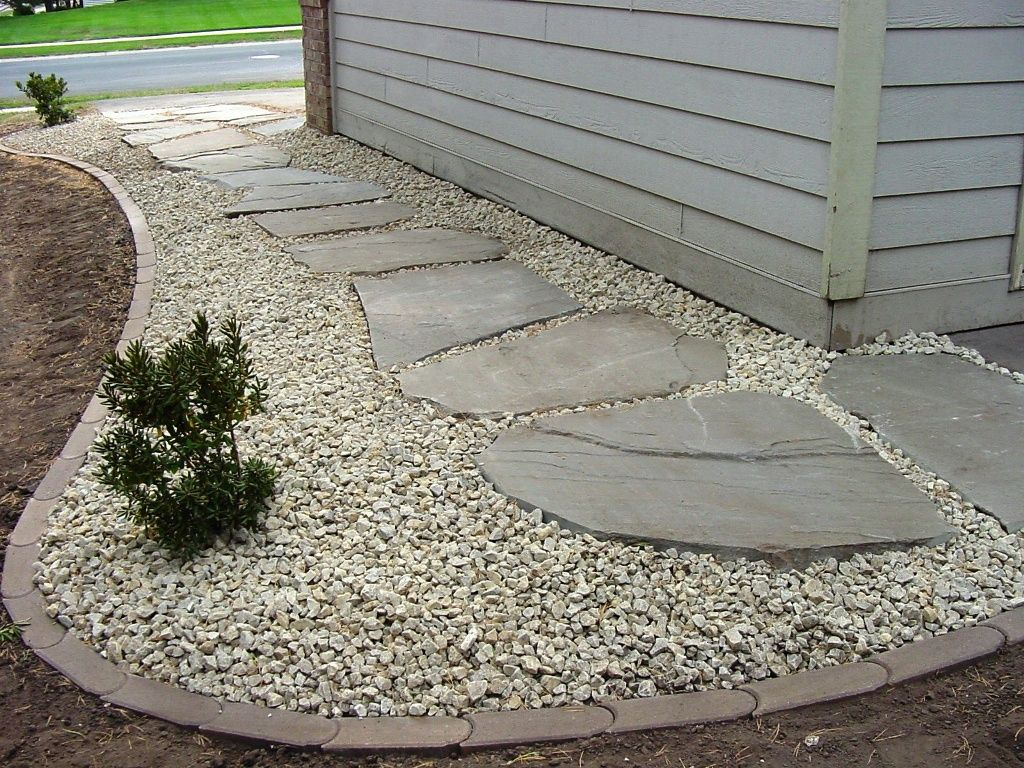 Cover french drain path like this with gravel rock set in for Rock stepping stones landscaping