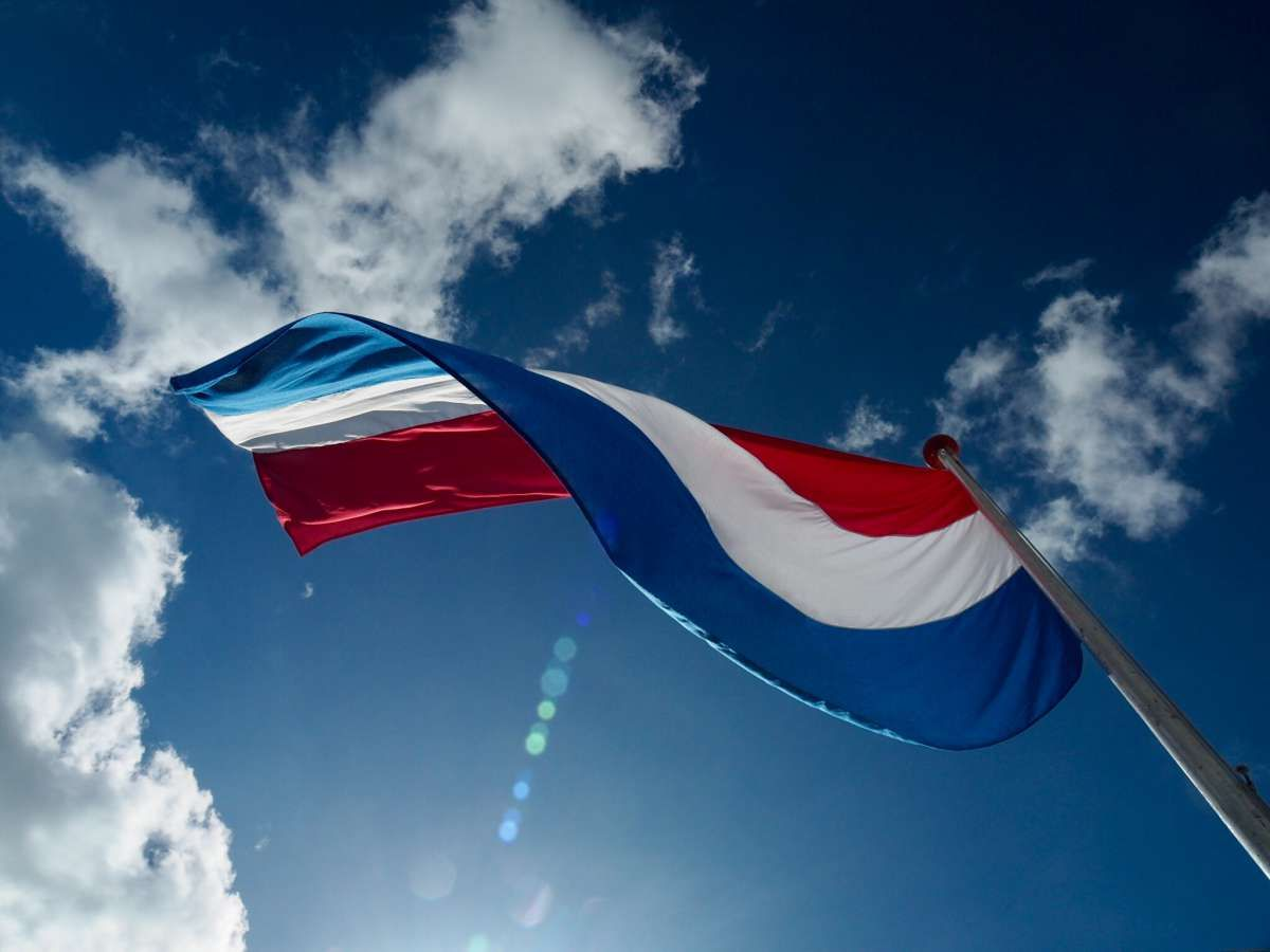 National Flag high in the Flagstick is a sign of Freedom for The Netherlands. With a twist because we know not everywhere in the world is peace as it should be! by Ellen Kop