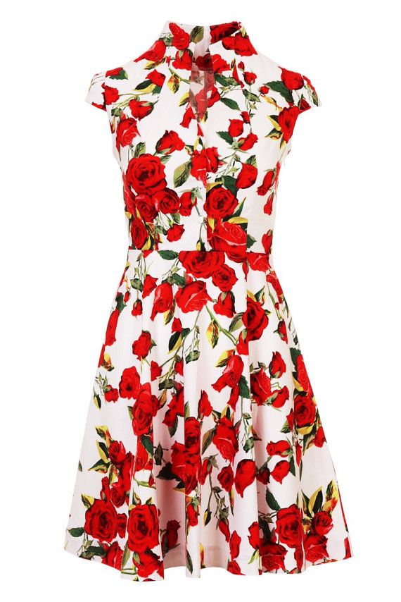 5c01adf5abcd Beautiful floral summer dress with red roses in a white background. This  dress is very elegant with a vintage look, and it is ideal for countless