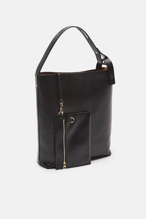 """""""Brands need to move at the speed the world does, and today, that is fast,"""" says Loewe creative director Jonathan Anderson. The same can be said for one's accessories. Crafted in Spain of smooth black leather lined in suede, this bag is designed to meet the demands of a fast-paced world. With an internal magnetic snap closure, the streamlined style can be slung over the shoulder or carried as a tote. A detachable zippered pocket keeps essentials close at hand and can double as a clutch."""