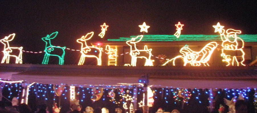 Santa With His Sleigh And Reindeer On A Roof Melbourne Christmas Light Display To Enjoy