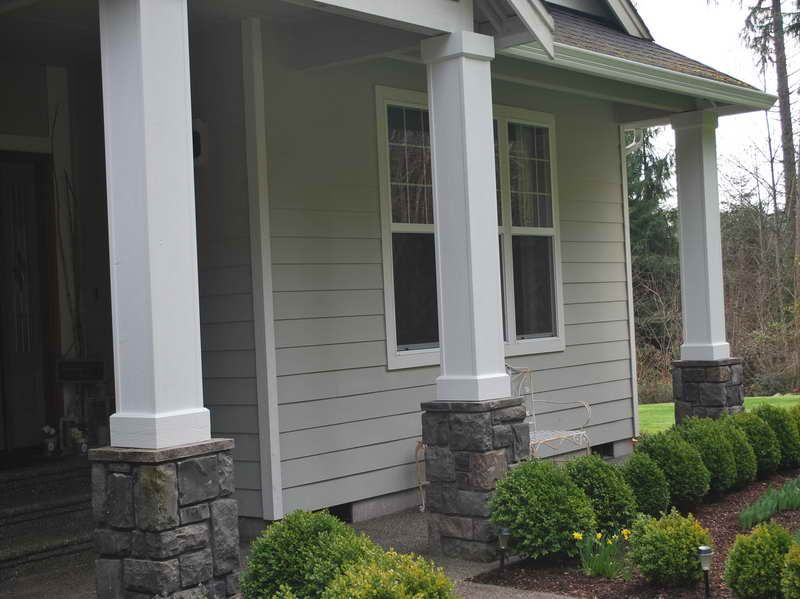 Front porch columns with grey paint under construction for Front porch pillars design