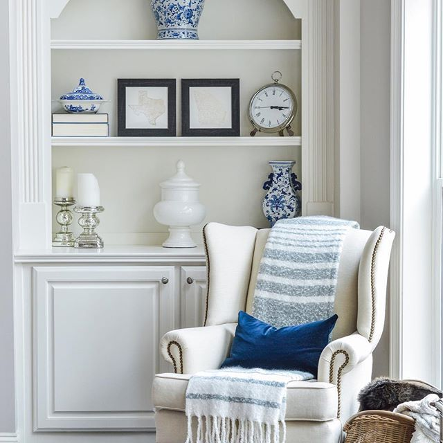 blue and white in elegant living room with styled built in bookshelves great room