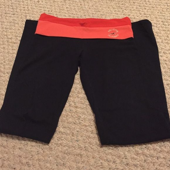 Hollister Yoga Pants Navy Hollister yoga pants with red/pink top band. These are flare leg. In excellent condition only worn once or twice Hollister Pants