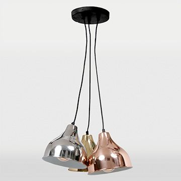 A cluster of hanging metal shades in brass, silver and copper. From Ren-Wil