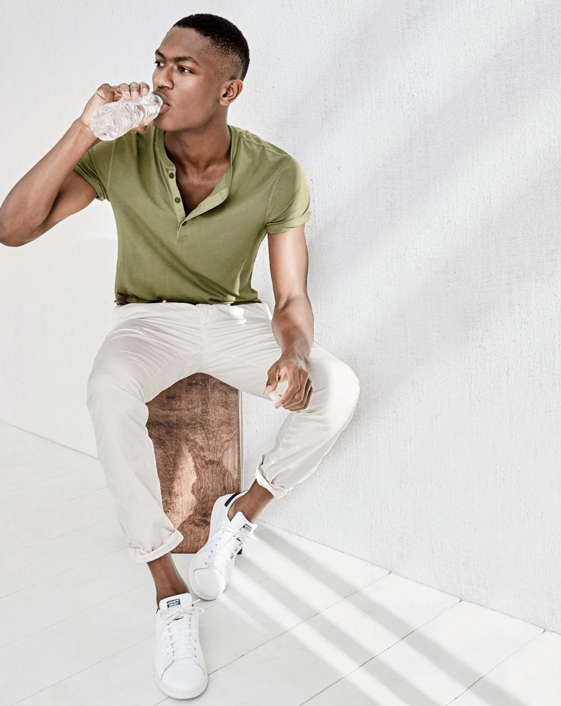 38b82c2bc1e791 J.Crew men's slim broken-in short-sleeve Henley, lightweight garment-dyed  stretch chino pant in 484 fit and Adidas® Stan Smith™ sneakers.