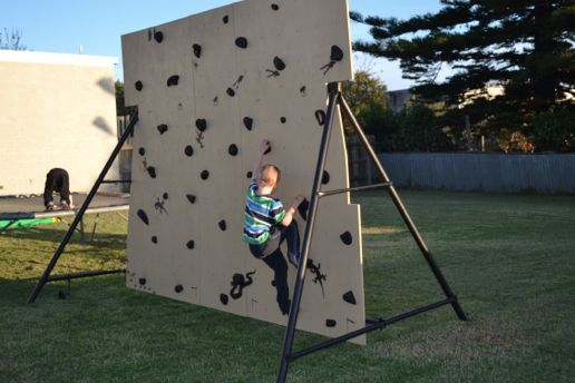 Repurposed Swing Set Climbing Wall This is an awesome