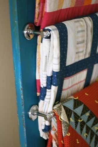 DIY blanket storage: towel bars inside closet door