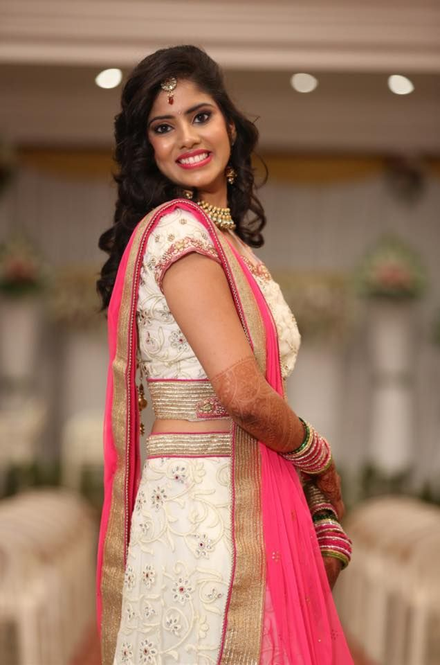 Indian bride wearing bridal lehenga and jewellery. Reception look. Makeup and hairstyle by Swank ...