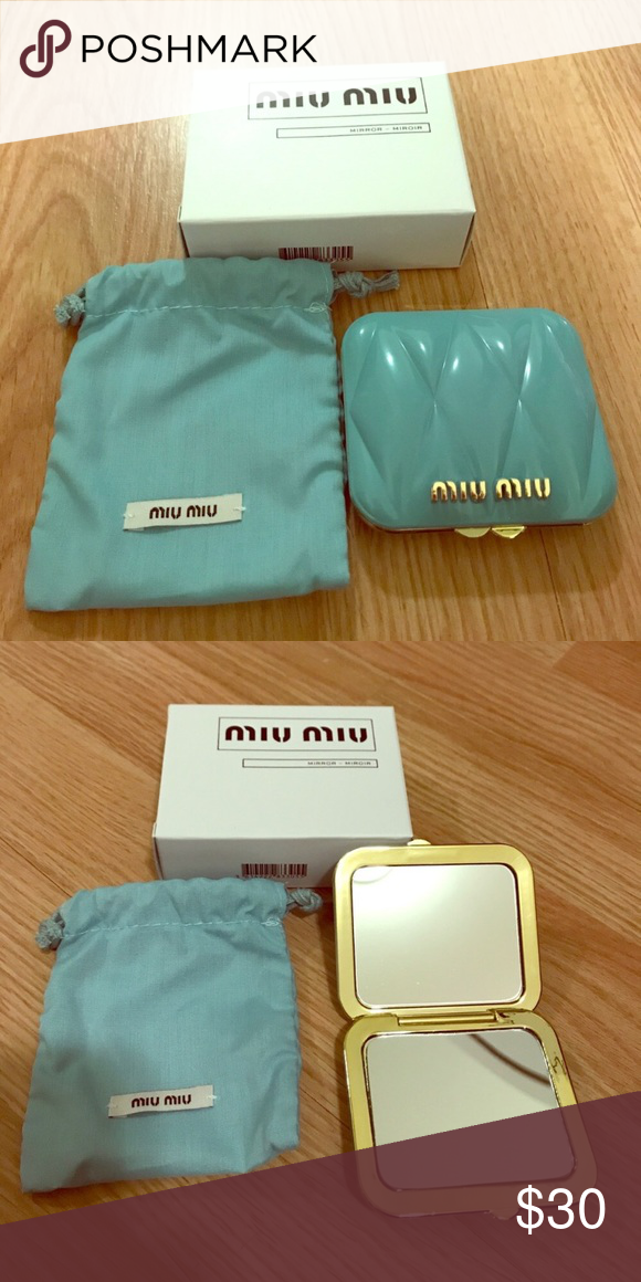 Authentic Miu Miu Compact Mirror with Dust bag New in box. Light blue with  gold metal accents. One side is regular. One side is magnifying. 3a62eecfde306