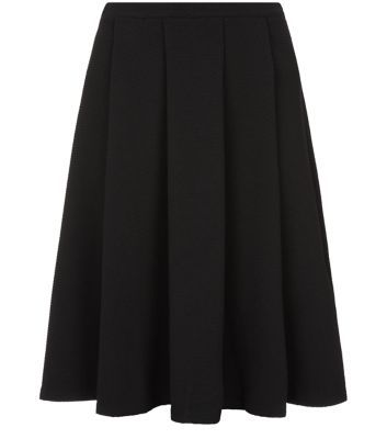 "Inspire. Try this black midi skirt with a scuba crop top and black ankle strap heels, for a sophisticated party look.- Simple sleeveless style- Fitted waist- Flared design- Waffle textured finish- Woven fabric- Model is 5'9""/180cmInspire is created for women of size 18 to 28/EU 46 to 56**Selected styles are available up to size 32/ EU 60"