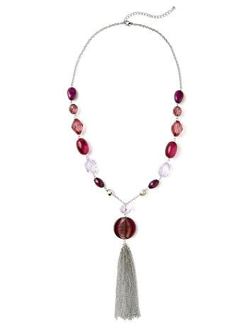 Distinct necklace has a chain link strand that leads to sleek stones and large, simulated glass beads in beautiful shades. A single, amulet-like embellishment dangles at the center, with chain link tassels falling below. Features a lobster claw closure with extender. Customized in size and scale for the plus size woman. For your comfort, all Catherines jewelry is free of lead and nickel. catherines.com
