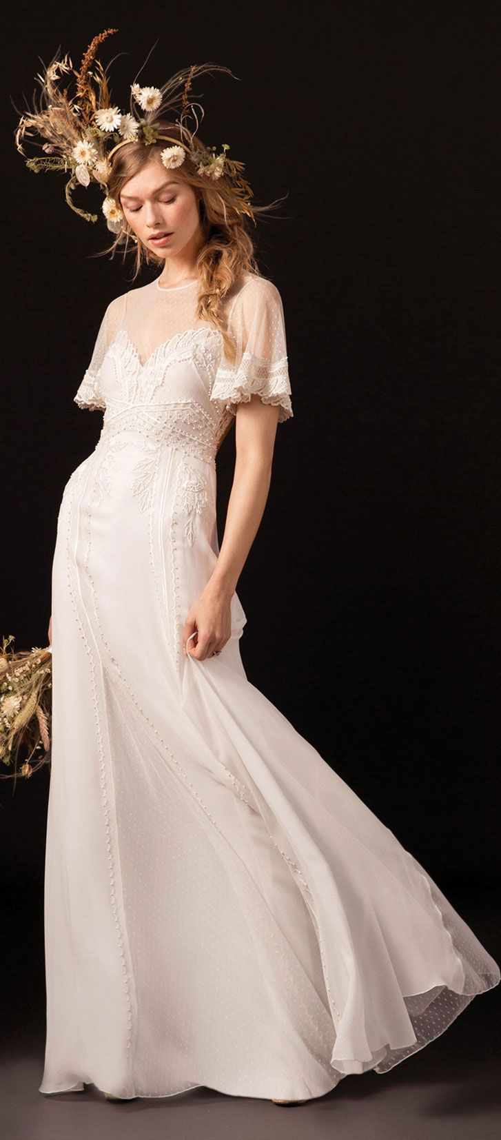 Short and flare sleeve silhouette flares into a fluid skirt #weddingdress #wedding #weddinggown