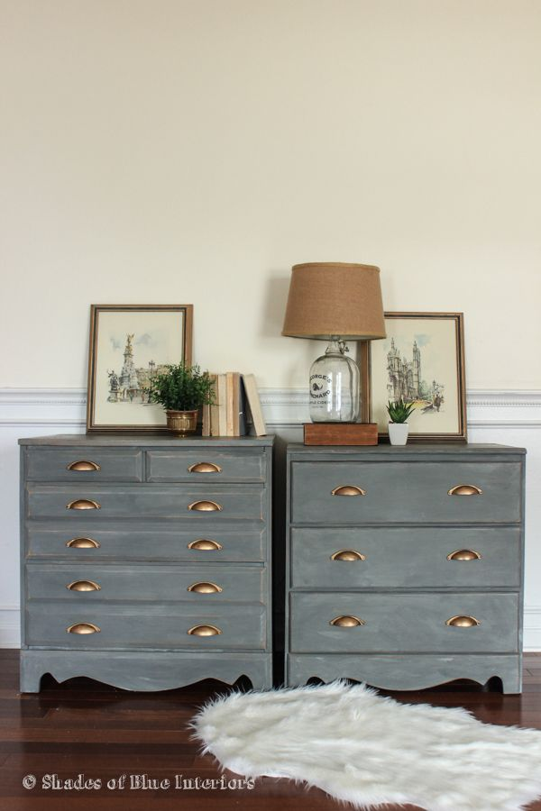 A Pair Of Charcoal Gray Nightstands With Gold Cup Pulls