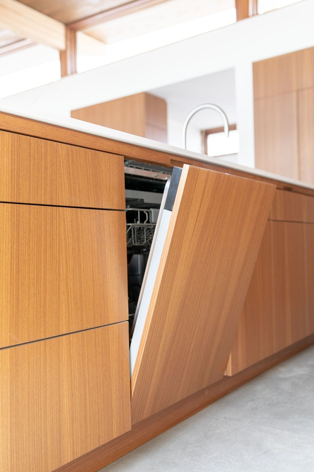 Kitchen And Dishwasher To Complement The Sleek Clean Aesthetic Of
