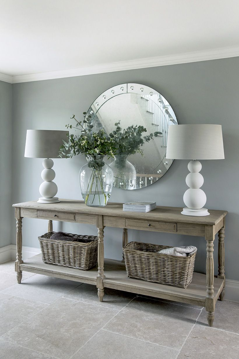 Photo of The Garden House Entrance Hall with stone flooring and a console table
