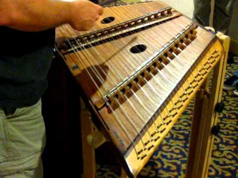 ''scarborough faire,'' on a hammered dulcimer - medieval instrument - english folk song