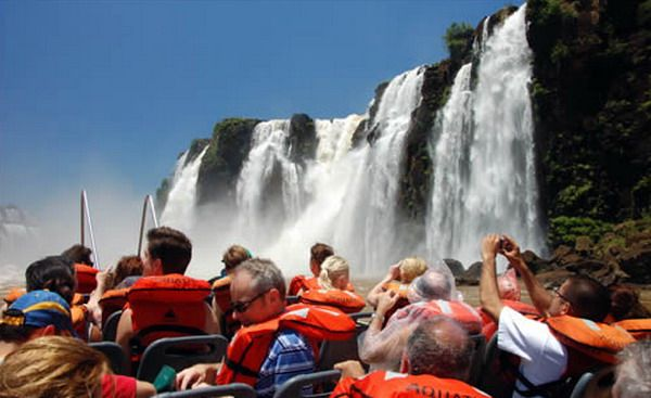 Went under Iguazu falls in a raft  in Brazil.