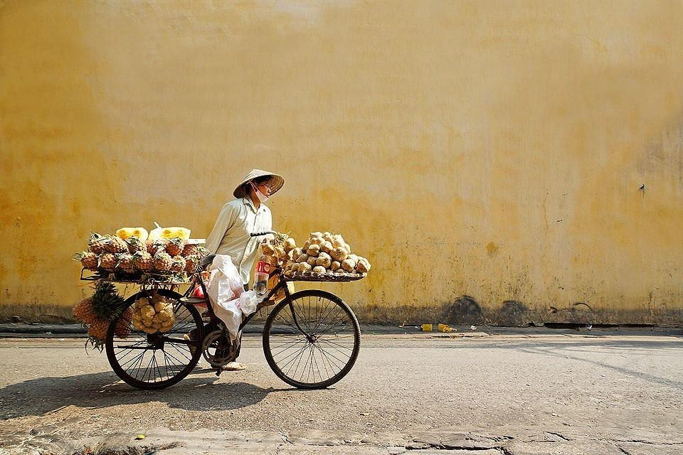 Pulling the life - A woman with her movable shop @ Hanoi's ancient street. Autumn 2013.