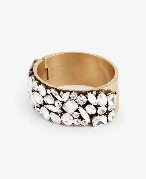 "Topped+with+glittering+crystals,+this+striking+wrist+topper+glamorizes+any+ensemble.+1""+width."