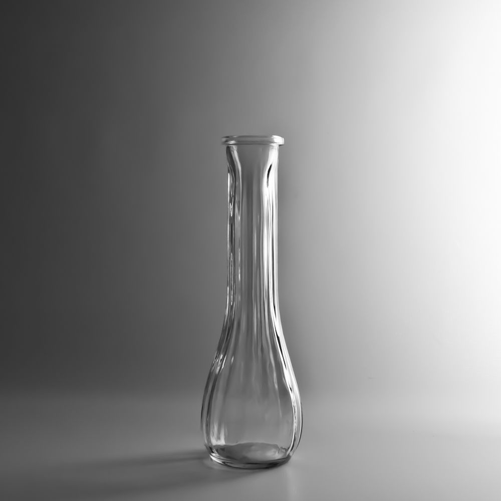 Fluted glass bud vase tall has a