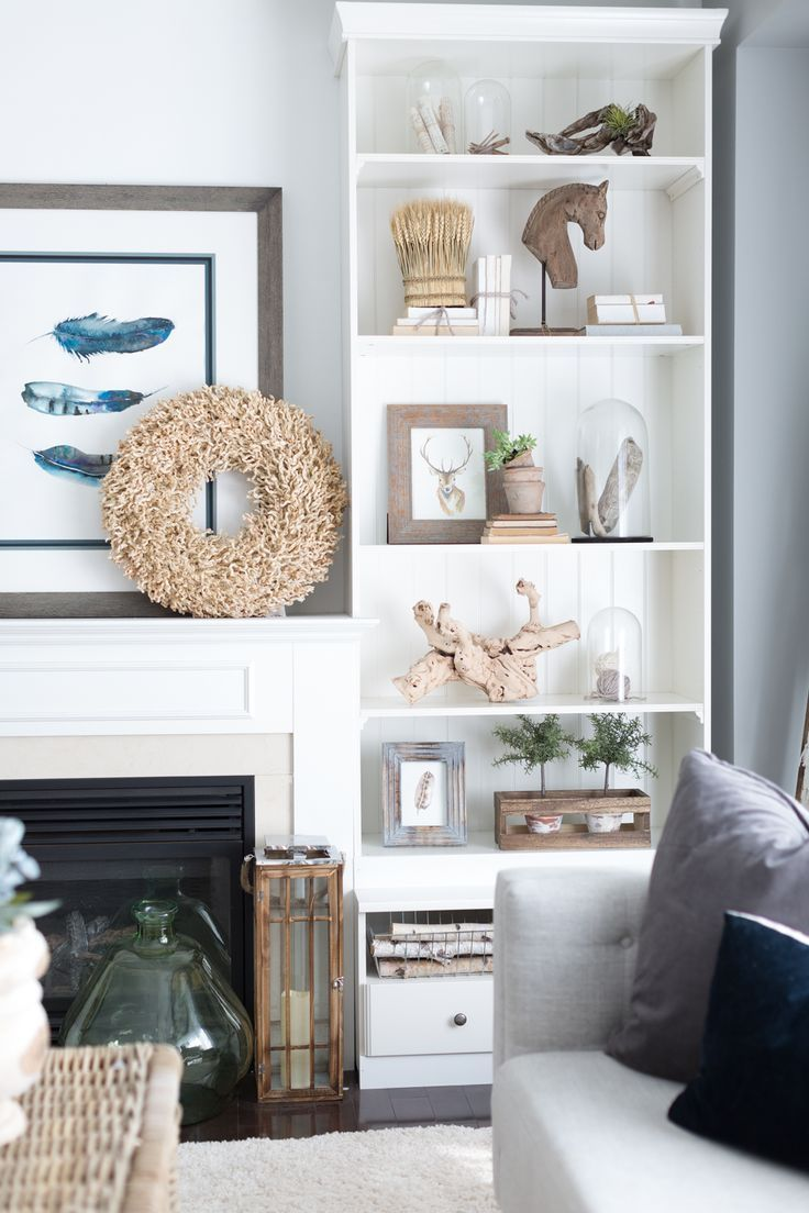 Beautiful fall living room - love the neutral finds on the bookshelf ...