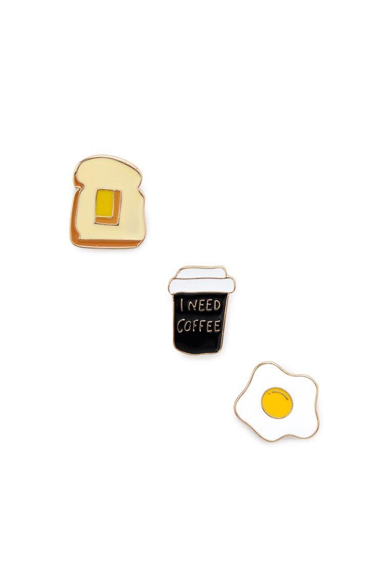 A set of three high-polish pins including fried egg, toast