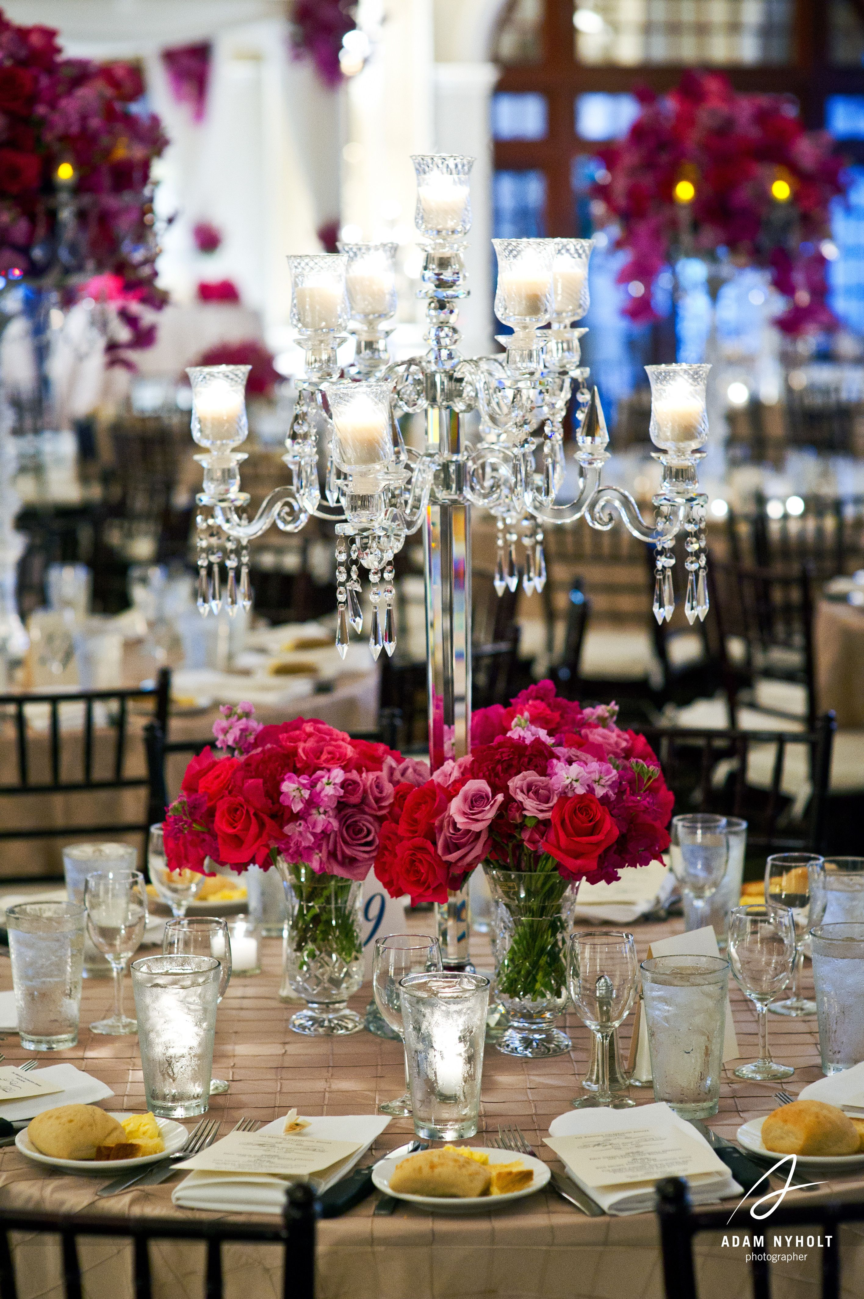 Wedding decorations red  Pink red and purple centerpiece flowers Photography by Adam Nyholt