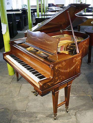 grand piano with a beautifully inlaid, r rosewood case http://adjustablepianobench.net