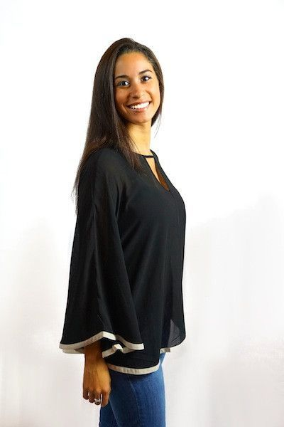 An oversized and comfortable blouse with a stand out trim. A go toitem that can be worn forvarious occasions. This is one of our favorite blouses!  100% Polyester   Shop this product here: spree.to/auzk   Shop all of our products at http://spreesy.com/JewelsByScarlett      Pinterest selling powered by Spreesy.com