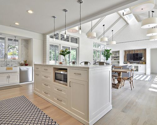 Example Of A Country Open Concept Kitchen Design In Austin With A Farmhouse  Sink, White