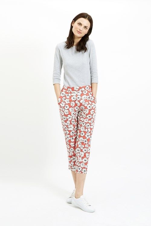 Coral woven trouser with floral print in 100% organic certified cotton. Side pockets with elasticated rear waistband. Length 88cm.