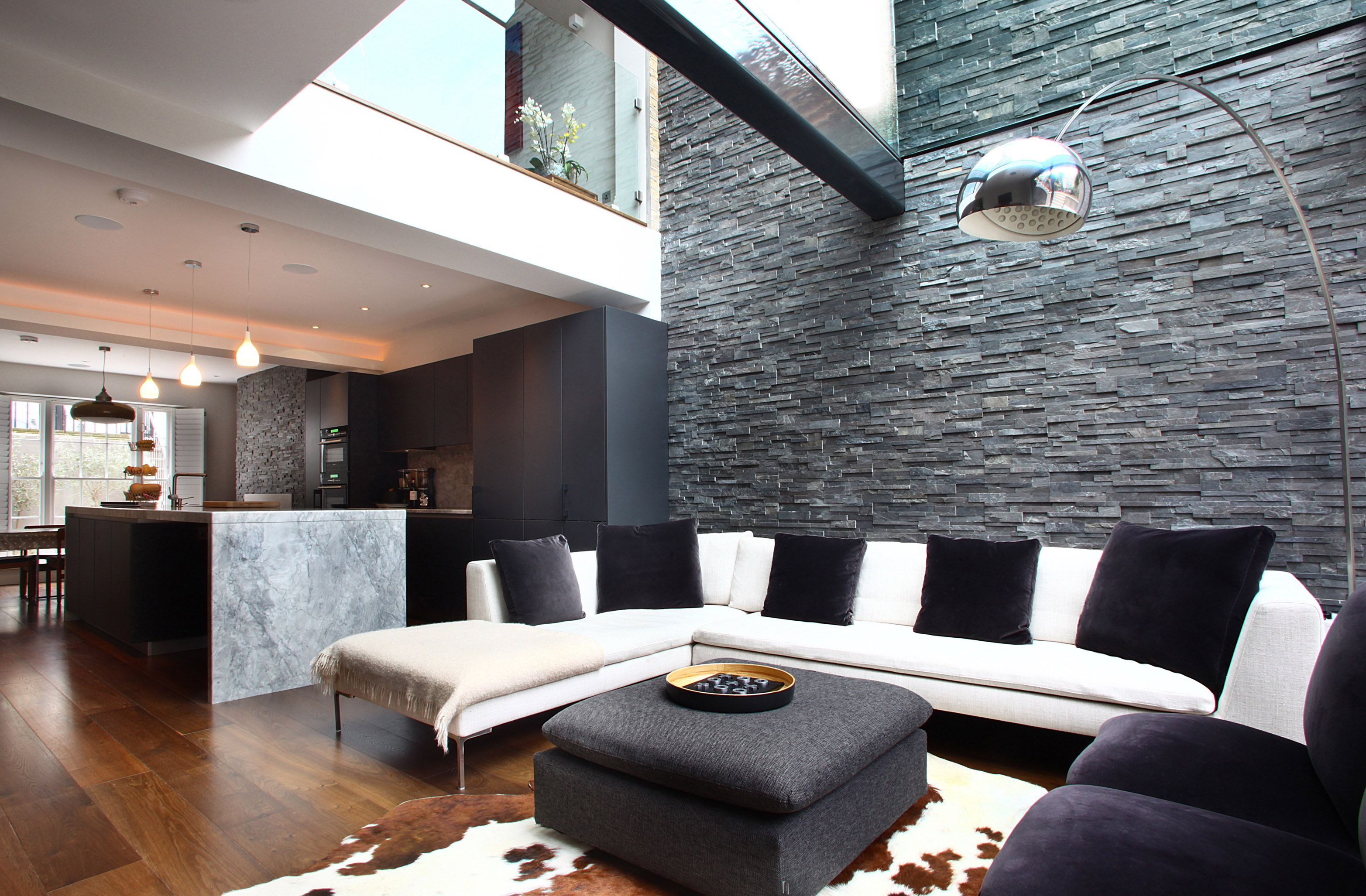 chelsea town house slate feature wall and exposed beam - Slate House Design