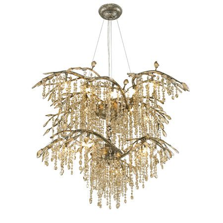 Inspired by a forest canopy, this beautiful mystic gold-finished ...