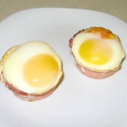Baked Eggs in Canadian Bacon Cups Allrecipes.com