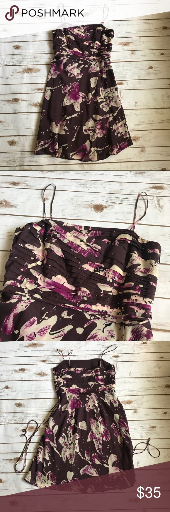 ANN TAYLOR Floral Dress Ann Taylor dress in purple floral print. Bodice is layered tiers. Size 4. There is a belt attached to this with in tact belt loops. Can be wrapped around a variety of ways and tied in a bow or hung loose. Ann Taylor Dresses