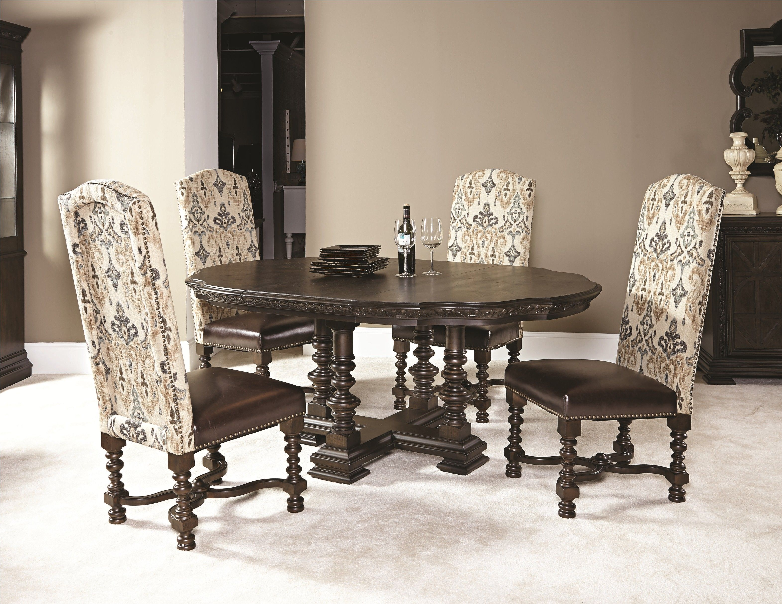 A 60inch round dining table from the Casalone collection by
